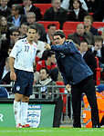 England manager Fabio Capello talks with David Bentley during the Friendly International match at Wembley Stadium, London. Picture date 28th May 2008. Picture credit should read: Simon Bellis/Sportimage