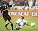 01 March 2007: Olimpia's Wilson Palacios (8) tackles the ball away from DC United's Bobby Boswell (left). DC United defeated CD Olimpia of Honduras 3-2 at RFK Stadium in Washington DC in the second leg of a CONCACAF Champions Cup quarterfinal competition.  DC United advanced by an aggregate score of 7-3.