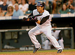 25 August  2007:  Colorado Rockies second baseman, Kazuo Matsui lays down a bunt during the Rockies 5-1 victory over the Washington Nationals at Coors Field, Denver Colorado.