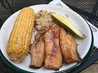 NWA Democrat-Gazette/FLIP PUTTHOFF <br />A smoked trout dinner is a fine feast after a day on the river. The trout on this plate were caught with jigs.