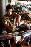 USA, California, Oakland, Chop Bar, Bartender preparing a Basil Gimlet