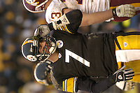 28 November 2004:  Ben Roethlisberger picks turf out of his helmet after a sack.<br />