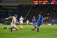 Lee Tomlin of Cardiff City shoots under pressure from Michael Dawson of Hull City during the Sky Bet Championship match between Cardiff City and Hull City at the Cardiff City Stadium, Cardiff, Wales on 16 December 2017. Photo by Mark  Hawkins / PRiME Media Images.