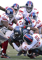 Seattle Seahawks running back Maurice Morris is tackled by six New York Giants during the NFL Game Action at Qwest Field in Seattle, Wash., on Sunday, Sept. 24, 2006.