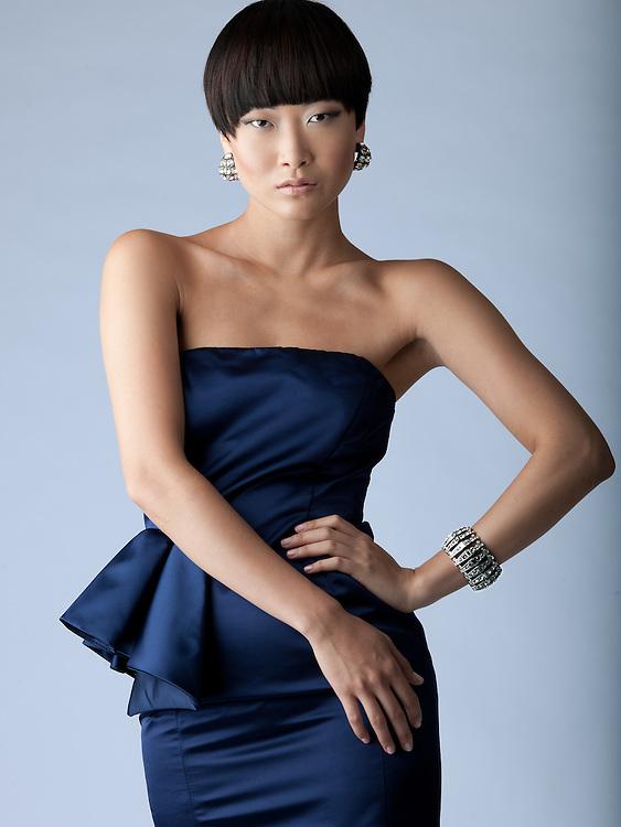 Beautiful asian brunette model in silver blue dress
