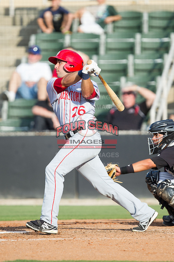 Carlos Lopez (26) of the Hagerstown Suns follows through on his swing against the Kannapolis Intimidators at CMC-Northeast Stadium on May 31, 2014 in Kannapolis, North Carolina.  The Intimidators defeated the Suns 3-2 in game one of a double-header.  (Brian Westerholt/Four Seam Images)
