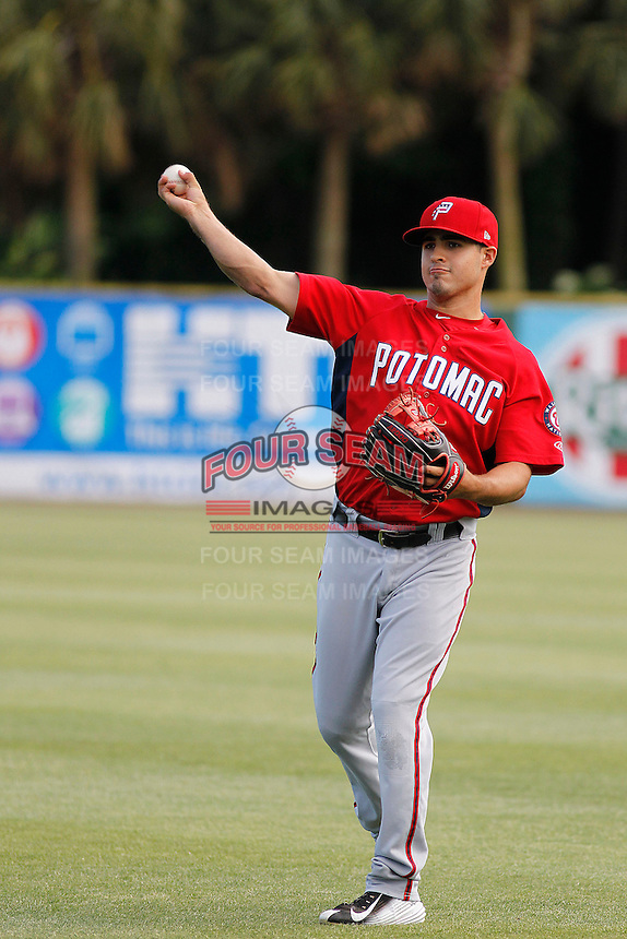Potomac Nationals shortstop Stephen Perez (4) throwing in the outfield before a game against the Myrtle Beach Pelicans at Ticketreturn.com Field at Pelicans Ballpark on May 25, 2015 in Myrtle Beach, South Carolina.  Myrtle Beach defeated Potomac 3-0. (Robert Gurganus/Four Seam Images)