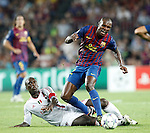 Barcelona's Eric Abidal and AC Milan's Clarence Seedorf during Champions League match on september 13th 2011...Photo: Cesar Cebolla / ALFAQUI