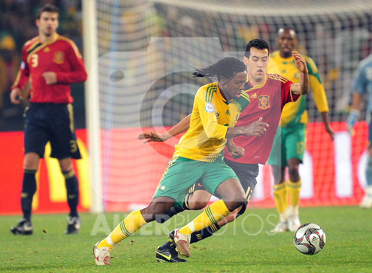 Macbeth Sabaya and Sergio Busquets  during the soccer match of the 2009 Confederations Cup between Spain and South Africa played at the Freestate Stadium,Bloemfontein,South Africa on 20 June 2009.  Photo: Gerhard Steenkamp/Superimage Media.