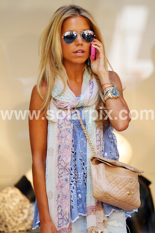 **ALL-ROUND PICTURES FROM SOLARPIX.COM**.**SYNDICATION RIGHTS FOR UK, USA AND CANADA ONLY**.Sylvie Van der Vaart shopping in Madrid, where she is in holiday with her husband, Dutch footballer, Rafael Van der Vaart, who plays for Real Madrid..Sylvie went under surgery for breast cancer a few months ago in Madrid..This pic: .JOB REF: 9450   SKX      DATE:  08.07.09.**MUST CREDIT SOLARPIX.COM OR DOUBLE FEE WILL BE CHARGED**.**NOTIFICATION OF ONLINE USAGE TO PHOTO @ SOLARPIX.COM**.**CALL SOLARPIX : +34 952 811 768 or LOW RATE FROM UK 0844 617 7637**