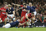 Scotland hooker Scott Lawson tackles Wales captain Sam Warburton.<br /> RBS 6 Nations 2014<br /> Wales v Scotland<br /> Millennium Stadium<br /> <br /> 15.03.14<br /> <br /> &copy;Steve Pope-SPORTINGWALES