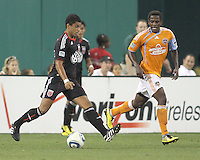Junior Carreiro #30 of D.C. United walks the ball past Lovel Palmer#22 of the Houston Dynamo during an MLS match at RFK Stadium in Washington D.C. on September  25 2010. Houston won 3-1.