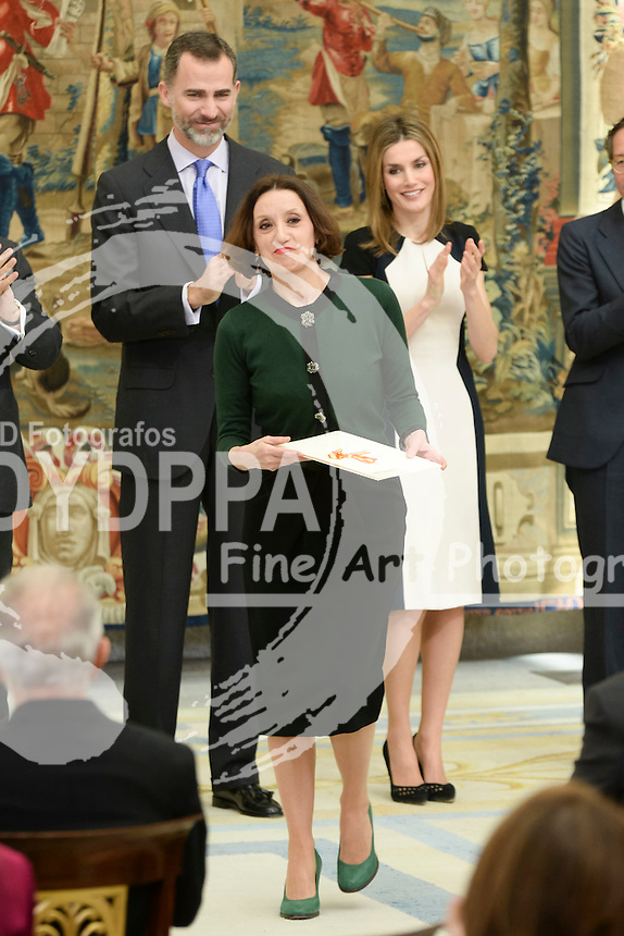 The Kings of Spain, Felipe and Letizia, attend the delivery of the National Culture awards at the Palace of El Pardo, Madrid, Spain. February 16, 2015. In the image: King Felipe, Queen Letizia and Spanish singer Luz Casal.  (C) Ivan L. Naughty / DyD Fotografos