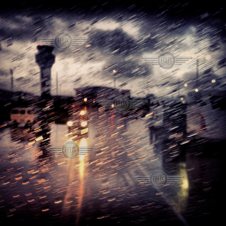 Vehicles drive in the rain at the new airport, Mariscal Sucre International.