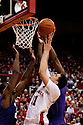 23 February 2011: Jorge Brian Diaz #21 of the Nebraska Cornhuskers is blocked by Jordan Henriquez-Roberts #21 of the Kansas State Wildcats while trying to shoot over Curtis Kelly #24 during the second half at the Devaney Sports Center in Lincoln, Nebraska. Kansas State defeated Nebraska 61 to 57
