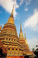 Upward view of trio of chedi, Wat Pho, Bangkok, Thailand