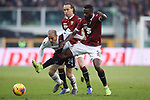 Rodrigo Palacio of Bologna battles against Nicolas Nkoulou of Torino FC as Diego Laxalt of Torino FC looks on during the Serie A match at Stadio Grande Torino, Turin. Picture date: 12th January 2020. Picture credit should read: Jonathan Moscrop/Sportimage