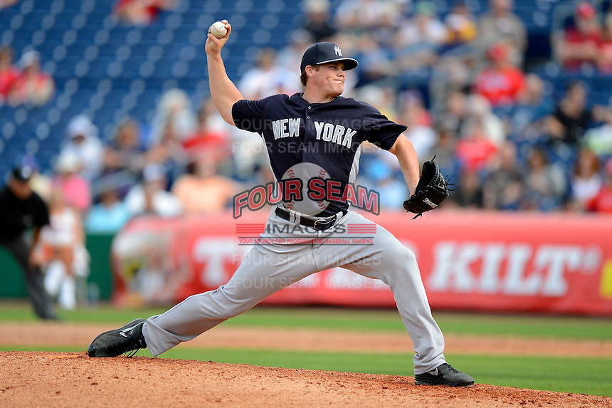 New York Yankees pitcher Brandon Pinder #99 delivers a pitch during a Spring Training game against the Philadelphia Phillies at Bright House Field on February 26, 2013 in Clearwater, Florida.  Philadelphia defeated New York 4-3.  (Mike Janes/Four Seam Images)