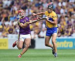 Lee Chin of Wexford in action against Cathal Malone of Clare during their All-Ireland quarter final at Pairc Ui Chaoimh. Photograph by John Kelly.