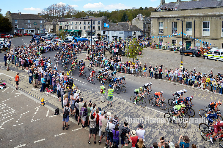 Picture by Shaun Flannery/SWpix.com - 05/05/2018 - Cycling - 2018 Tour de Yorkshire - Stage 3: Richmond to Scarborough - Yorkshire, England<br /> <br /> The peloton in Leyburn