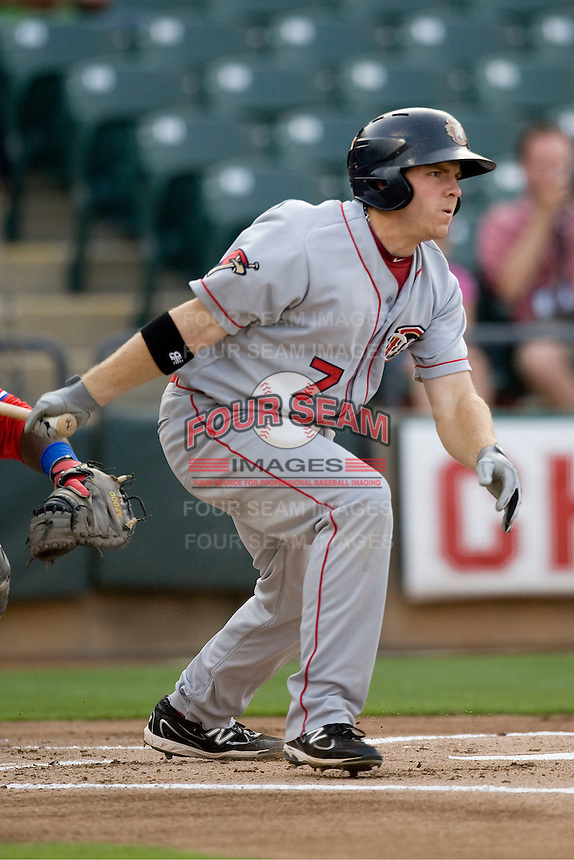 Outfielder JB Shuck #7 of the Oklahoma City RedHawks singles against the Round Rock Express on April 26, 2011 at the Dell Diamond in Round Rock, Texas. (Photo by Andrew Woolley / Four Seam Images)