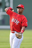 Third baseman Rafael Devers (13) of the Greenville Drive warms up before a game against the Charleston RiverDogs on Friday, August 14, 2015, at Fluor Field at the West End in Greenville, South Carolina. Charleston won 6-2. (Tom Priddy/Four Seam Images)