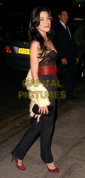 JAIME MURRAY.The Gina Shoes 50th Anniversary Party, Dorchester Hotel, London, UK..September 19th, 2006.Ref: CAN.full length jeans denim red shoes belt fur wrap strapless lace.www.capitalpictures.com.sales@capitalpictures.com.©Can Nguyen/Capital Pictures