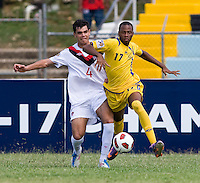 Ismail Benomar (4) of Canda tries to clear the ball away from Zari Prescod (17) of Barbados during the group stage of the CONCACAF Men's Under 17 Championship at Jarrett Park in Montego Bay, Jamaica. Costa Rica defeated El Salvador, 3-2.
