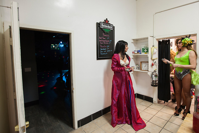 Melanie Machetto (left) talks with Sophia Celina before they perform in a drag show at Franco's Norma Jean's Nightclub in Castroville, Calif. on December 18, 2015.