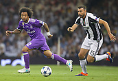 June 3rd 2017, National Stadium of Wales , Wales; UEFA Champions League Final, Juventus FC versus Real Madrid; Marcelo of Real Madrid and Andrea Barzagli of Juventus battle for possession during the match