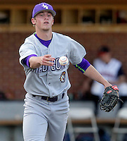 James Madison pitcher Ben Garner (11) tosses the ball to first base during the game against James Madison University Tuesday in Charlottesville, VA.  Photo/The Daily Progress/Andrew Shurtleff