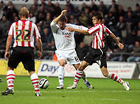 Pictured: Gorka Pintado of Swansea (C) challenged by Jack Cork of Southampton (R)<br /> Re: Coca Cola Championship, Swansea City Football Club v Southampton at the Liberty Stadium, Swansea, south Wales 25 October 2008.<br /> Picture by Mike Greenslade / Dimitrios Legakis Photography, Swansea, 07815441513
