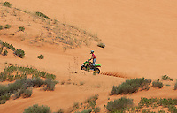 738900009 an atv rider cruises among the dunes and fir trees in coral pink sand dunes state park utah
