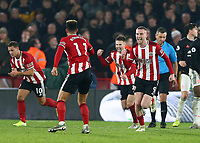 24th November 2019; Bramall Lane, Sheffield, Yorkshire, England; English Premier League Football, Sheffield United versus Manchester United; Oliver McBurnie of Sheffield United  celebrates after he scores in the 90th minute to make it 3-3 with Billy Sharp of Sheffield United and Oliver Norwood  of Sheffield United close by the goal was given after a VAR decision - Strictly Editorial Use Only. No use with unauthorized audio, video, data, fixture lists, club/league logos or 'live' services. Online in-match use limited to 120 images, no video emulation. No use in betting, games or single club/league/player publications
