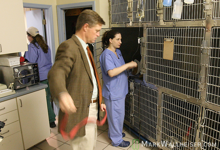 Dr. Leslie Campbell, left, Dr. George Simmons, center, and Lauren Schuster inside the Allied Veterinary Emergency Hospital in Tallahassee, Florida at just after 7 am Jan. 30, 2007.  (Mark Wallheiser/TallahasseeStock.com)
