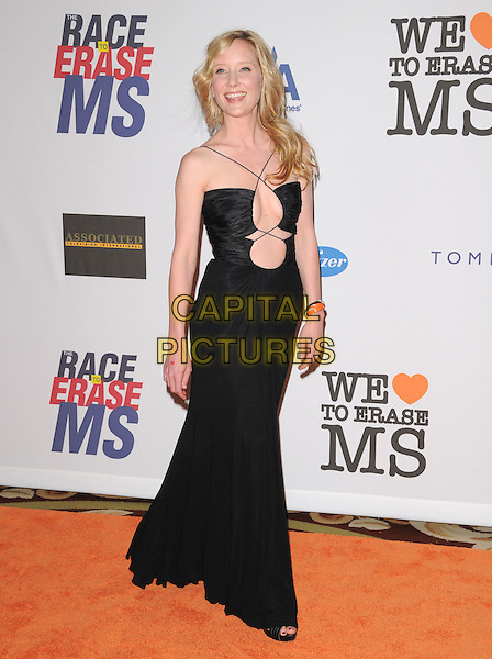 ANNE HECHE.Attending The 15th Annual Race to Erase MS Fundraiser held at The The Hyatt Regency Century Plaza Hotel in Century City, California, USA,.May 02 2008..full length black dress cu out straps cleavage                                                                 .CAP/DVS.©Debbie VanStory/Capital Pictures