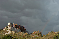 A big rainstorm approching the Potala in the late afternoon, witha rainbow appearing..Little remains of the original Potala Palace of the seventh century, built as a place for meditation by King Songtsen Gampo on the occasion of his marriage to Princess Wencheng of the Tang Court. Standing atop the Red Hill in Lhasa, the current structure dates from the 17th century; it was rebuilt by the 5th Dalai Lama and became the Winter Palace of the Dalai Lamas from that time. The 13-story building of 1,000 rooms can be seen from many miles away...The Potala is divided into two sections--an outer section, the White Palace, and an inner section, the Red Palace, the latter containing the temples and reliquary tombs of the Dalai Lamas. The entire building is a structure of stone and timber. At a height of 117 meters, the Potala was the world's tallest building until 20th-century architects designed cityscapes of new buildings that far surpassed the Potala in height--but not in its architectural majesty..