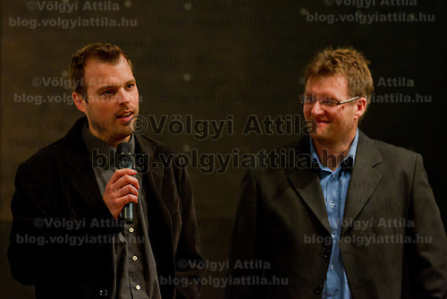 Attila David Molnar (L) and Zsolt Marcell Toth (R) nature movie makers attend a press conference where nature photographer Bence Mate (not pictured) from Hungary presents the documentary showing his work in Budapest, Hungary on December 12, 2011. ATTILA VOLGYI