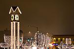 The Clock tower and lighted trees on a foggy night near Christmas. Coeur d' Alene, Iaho.