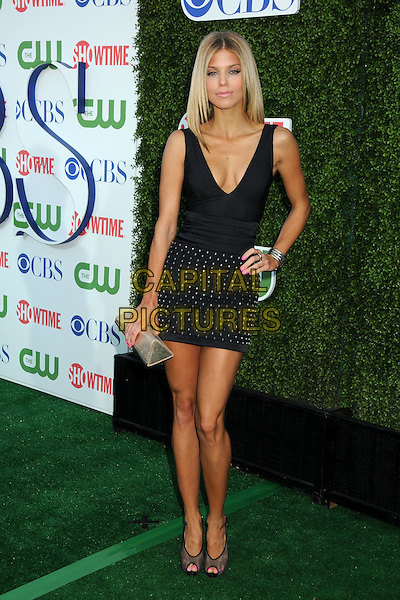 ANNALYNNE McCORD.CBS Summer Press Tour Party 2010 held at The Tent, Beverly Hills, California, USA..July 28th, 2010.full length sleeveless dress hand on hip silver clutch bag low cut neckline v-neck cleavage beads beaded black mesh peep toe shoes grey gray black.CAP/ADM/BP.©Byron Purvis/AdMedia/Capital Pictures.