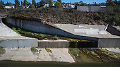 Storm drain emptying into Ballona Creek. Once a meandering creek, Ballona Creek is now a concreted nine-mile flood channel that drains the Los Angeles Basin and watershed down into the Pacific Ocean, Culver City, California, USA