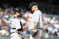 09/19/11 Bronx, NY: New York Yankees catcher Russell Martin #55 and starting pitcher A.J. Burnett #34 during an MLB game played at Yankee Stadium between the Minnesota Twins and the New York Yankees. The Yankees defeated the Twins 6-4.