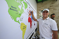 Alexander Noren (SWE) signs the world map after finishing his round during Sunday's Final Round of the rain shortened 2011 Barclays Singapore Open, Singapore, 13th November 2011 (Photo Eoin Clarke/www.golffile.ie)