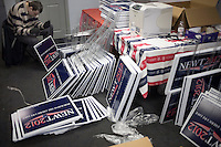 A volunteer puts together Gingrich campaign signs at the Newt Gingrich New Hampshire campaign headquarters in Manchester, New Hampshire, on Jan. 7, 2012. Gingrich is seeking the 2012 Republican presidential nomination.