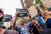 New York, USA 13 June 2016 - Vigil for the Lives Lost in Orlando -  In the wake of the mass shooting  that left at least 50 dead and more than 50 others wounded at Pulse, a gay nightclub in Orlando, Florida. the LGBTQ community and allies in came together outside the Stonewall Inn, on a second night to pay respect to the innocent people lost in this mass shooting, and speak out against ANTI-LGBT hate. ©Stacy Walsh Rosenstock/Alamy Live News