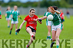 Rathmores Katie O' Mahony been tackled by Meabh Barry of  Na Gaeil in the Randles Bros Kerry LGFA Senior Football Championship.