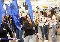 NWA Democrat-Gazette/FLIP PUTTHOFF <br />STRIKE UP THE BAND<br />Marissa Arnold (center) performs Tuesday April 10 2018 with the Bentonville Pride Marching Band at the Walmart store at the Pleasant Crossing shopping center in Rogers. The high schoool band was on hand to celebrate the national release of the movie, &quot;The Greatest Showman,&quot; said Alisha Pettigrew, a Bentonville band parent. Students performed the song, &quot;This Is Me,&quot; from the movie. Their performance was filmed as part of a marketing promotion for the movie, store personnel said. Students performed from 5 a.m. to 7 a.m. so shopper traffic wouldn't be impeded, Pettigrew said. Band members are used to early hours from traveling to band competitions, she added.