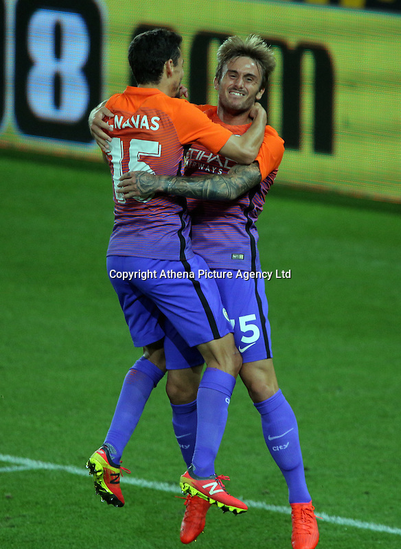 Aleix Garcia of Manchester City (R) celebrates his goal with team mate Jesus Navas during the EFL Cup Third Round match between Swansea City and Manchester City at The Liberty Stadium in Swansea, Wales, UK. Wednesday 21 September.