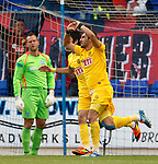 Veysel Sari celebrates after tapping in to equalise fot the Turks