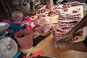 Butchers prepare cuts of meat for customers at a local wet market in Pandamaran in Klang, Selangor, Malaysia on October 16th, 2016. <br /> In September 1998, a virus among pig farmers (associated with a high mortality rate) was first reported in the state of Perak in Malaysia. Dr. Chua investigated and discovered the virus and it was later named, Nipah Virus. The outbreak in Malaysia was controlled through the culling of &gt;1 million pigs.